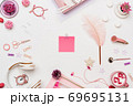 Woman workspace flat lay with paper sheet sticker 69695131