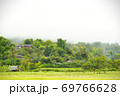 Rural villages of Thailand in the Asian zone and rice fields among the mountains and thick fog in the morning during the rainy season. The concept of people living with nature in perfect harmony. 69766628