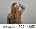 Posing with her back faced to camera, isolated over copy space background 70244865