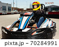 Woman driving sport car for karting in a circuit lap outdoor in sport club 70284991