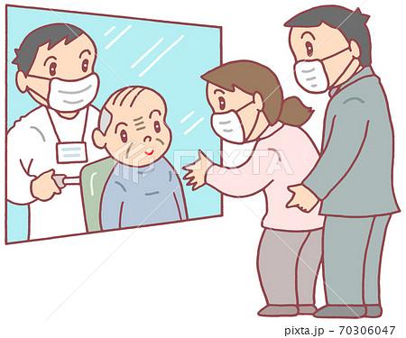 高齢者施設のガラス越し面会(お爺さん) 70306047