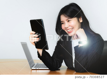 Successful asian senior businesswoman using digital tablet on isolated white background 70308527
