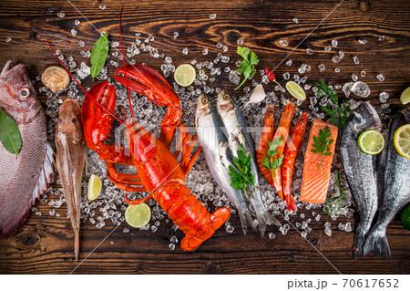 Fresh tasty seafood served on black stone table. 70617652