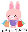 たくさん買い物をしているウサギイラスト素材 70662704