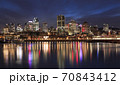 Montreal skyline illuminated at night with nice reflections in Saint Lawrence River, Quebec, Canada 70843412