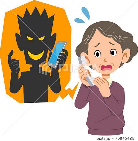 迷惑電話に焦るシニアの女性 70945439