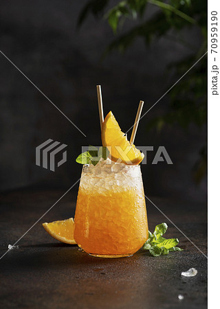 Fresh cold cocktial with orange, crushed ice and mint 70959190