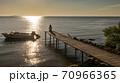 Woman Enjoying Sunset on Pier 70966365