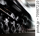 Wheels of an old steam locomotive, trains in motion. Close-up. 70987210