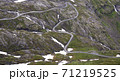 Narrow mountain road from Geiganger fjord to Dalsnibba mountain peak in Geiranger, Norway 71219525