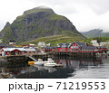 Fishing boats and red huts on the sea border in A village, Lofoten Islands, Norway 71219553