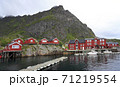 Fishing boats and red huts on the sea border in A village, Lofoten Islands, Norway 71219554