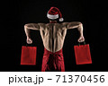 Athlete muscular man wear santa hat and apron. I have gift for you. Macho muscular torso posing 71370456