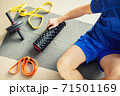 Top view of young man's arm holding exercise machine 71501169