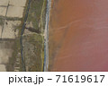 High angle drone view of pink lake where salt is extracted, Sasyk Sivash lake in Crimea 71619617