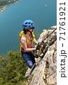 Beautiful Woman on Via Ferrata Trail 71761921