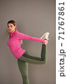 Side view of a sporty young female athlete running at home. Health conscious lifestyle 71767861