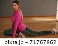 Beautiful teenage girl in sportswear, yoga position in a health club 71767862
