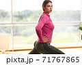 Image of beautiful young sporty blonde woman doing fitness exercises 71767865