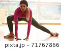 Young sport happy sexy blonde girl in green leggings and pink top doing yoga exercise 71767866