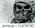 Stylized image of death with a rose on a concrete wall 71876792