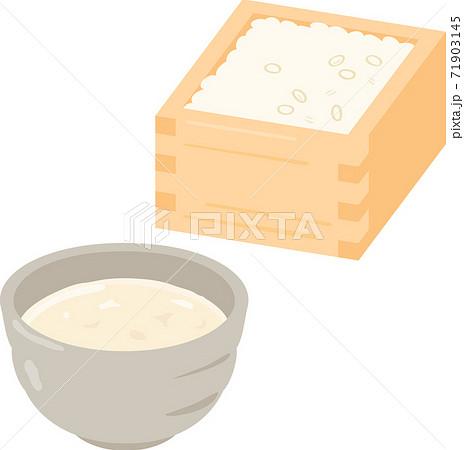 湯呑み茶碗に入った甘酒と升に入った米麹 71903145