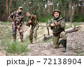 Old Man is Aiming Excited Young Hunters Watching. 72138904