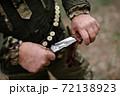 Brutal Hunting Knife in Professional Hunter Hands. 72138923