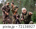 Family Man and Sons Hunting with Pointer Dog. 72138927