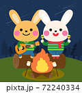 rabbits play music in front of the campfire 72240334