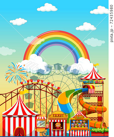 Amusement park scene at daytime with rainbow in 72435980