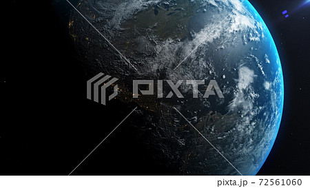 Space view of the sun rising on planet Earth, going from night to day with cloud formations and city lights . 3D animation. 72561060