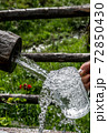 Big Glass Filled With Clear Mountain Drinking Water From A Wooden Spring 72850430