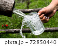 Big Glass Filled With Clear Mountain Drinking Water From A Wooden Spring 72850440