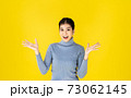 Photo of Advertising concept Asian women look good, positive thinking Are showing gestures. Happy, Surprise and success with yellow background and copy space. 73062145