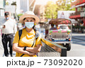 Asian women tourists visit Bangkok. A female traveller wearing a mask is looking at the camera while visiting a backpacker during the outbreak in new normal lifestyle with blur background, copy space. 73092020