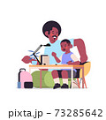 african american father helping son doing homework parenting fatherhood friendly family concept 73285642