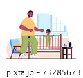 father playing with little son in crib fatherhood parenting concept dad spending time with his kid at home 73285673