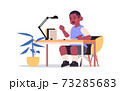 little african american boy studying and doing school homework education childhood concept 73285683