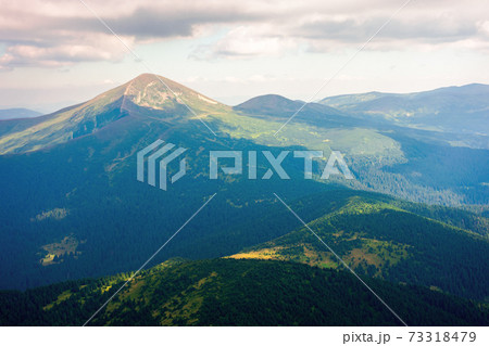 hoverla peak of carpathian black ridge. beautiful summer landscape at noon. clouds on the sky above the valley. view from petros mountain slope covered in grass 73318479