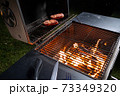 Meat on the grill, cooking in the open air in the evening 73349320
