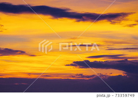dark clouds on the glowing sky at sunset. dramatic nature scenery on the windy weather in evening 73359749