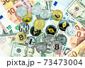 Various cryptocurrency coins on paper dollar and euro banknotes. Bitcoin, ethereum, litecoin and others modern virtual currency. Digital crypto. Metal cryptocurrency coins 73473004