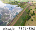 Drone shot aerial view scenic landscape of river reservoir dam and the forest 73714598