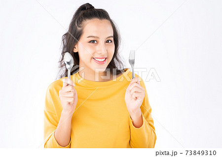 Asian woman showing Knife Fork prepare to eat food 73849310