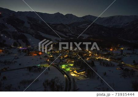白馬三山・八方尾根スキー場・ホテル街の美し夜景 長野県白馬村(ドローンによる空撮) 73935444