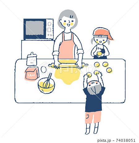 お菓子作りを楽しむお母さんと2人の子供 74038051