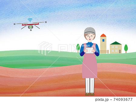 畑でドローンを操作する女性 74093677
