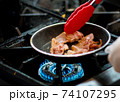 fresh fried bacon in a pan, Chef cooking in the kitchen 74107295