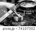 Chef cooking in a kitchen, chef at work, Black and White. 74107302